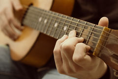 Acoustic guitar guitarist playing. Royalty Free Stock Photos