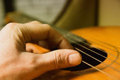 Acoustic guitar guitarist playing. Royalty Free Stock Photography