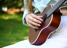 Acoustic guitar and hand Royalty Free Stock Photos