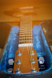 Acoustic guitar with hard case Royalty Free Stock Photos