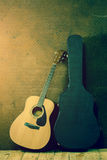 Acoustic guitar with hard case Stock Images