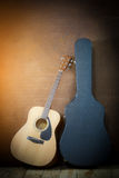 Acoustic guitar with hard case Stock Photography