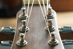 Acoustic guitar head stock and tuner Royalty Free Stock Photo