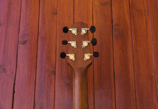 Acoustic Guitar Head. On wooden surface royalty free stock photography