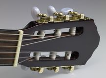 Acoustic guitar headstock. Headstock of a classic guitar Royalty Free Stock Photography
