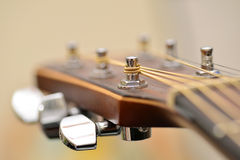 Acoustic guitar headstock. Chicken doll in the garden park Stock Photo