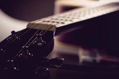 Acoustic guitar headstock. Closeup shot photo of the acoustic guitar Stock Photo