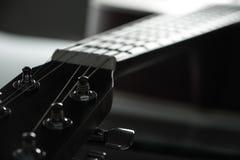Acoustic guitar headstock. Closeup shot photo of the acoustic guitar Royalty Free Stock Photo