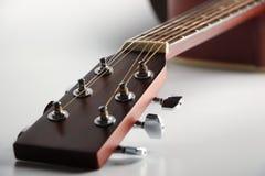Acoustic guitar headstock. Closeup shot photo of the acoustic guitar Stock Photos