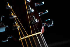 Acoustic guitar headstock. Closeup shot photo of the acoustic guitar Royalty Free Stock Image