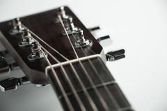Acoustic guitar headstock. Closeup shot photo of the acoustic guitar Stock Images
