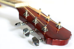 Acoustic guitar headstock on white. Close up of tuning peg on acoustic guitar headstock on white Stock Images
