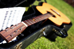 Acoustic Guitar In Case With Music Stock Photo