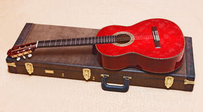 Acoustic guitar. Acoustic guitar and its case Stock Images