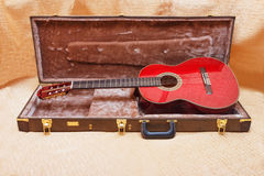 Acoustic guitar. Acoustic guitar and its case Royalty Free Stock Photo