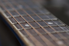Acoustic Guitar Keyboard. Photo of an acoustic guitar keyboard. Frets are easily visible. Strings are vibrating and they are sharp right on the 12th fret Royalty Free Stock Photos