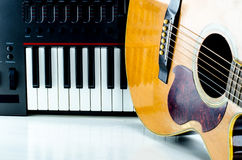 Acoustic guitar keyboard, close-up. royalty free stock photography