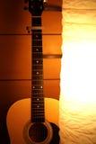 Acoustic guitar in lamp Stock Photos