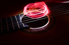 Acoustic guitar. With lightning whirl Royalty Free Stock Image