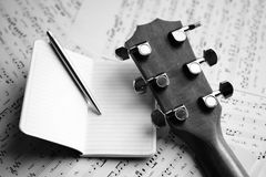 Acoustic guitar and music score Royalty Free Stock Photo