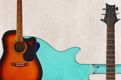 Acoustic guitar, neck and back of guitar body on cardboard background, with plenty of copy space. Royalty Free Stock Images