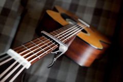 Acoustic guitar neck with a capo Royalty Free Stock Photography