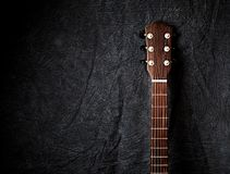 An Acoustic Guitar Neck on dark Cloth Background. Copy space Royalty Free Stock Image