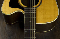 Acoustic guitar neck fingerboard frets strings music case close inlay creativity art sound vibration play music guitarist musician Stock Photography