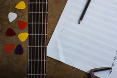 Acoustic guitar and note, selection focus Stock Photo