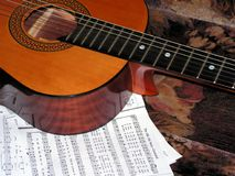 Acoustic guitar and notes Stock Images