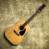 Acoustic guitar on old wall Stock Photo