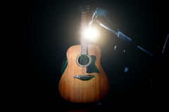 Acoustic guitar over black background. Acoustic wooden a guitar over black background. Music and concert concept Stock Photo