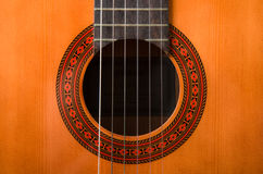 Acoustic guitar. Particular background of wood acoustic guitar with strings Royalty Free Stock Photo