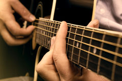 Acoustic Guitar Performance. Man playing acoustic guitar,useful for various music and entertainment themes Stock Images