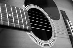 Acoustic guitar perspective. Black and white acoustic guitar Stock Photo