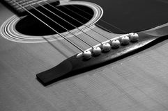 Acoustic guitar perspective. Black and white acoustic guitar Stock Image