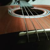 Acoustic guitar in perspective Royalty Free Stock Photos