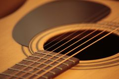 Acoustic guitar photo in cozy, warm tones royalty free stock image