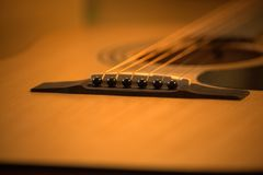 Acoustic guitar photo in cozy, warm tones stock photo