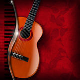 Acoustic Guitar and Piano Red Flowers Royalty Free Stock Photography