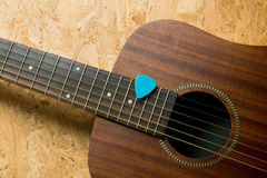 Acoustic guitar with pick stock photos