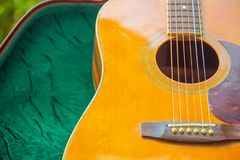 Acoustic guitar that is placed in the garden at home stock image