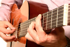 Acoustic guitar player close-up. With focus on the player's hand Stock Photos