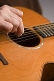 Acoustic guitar player fingerpicking Royalty Free Stock Photography
