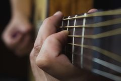 Free Acoustic Guitar Player Performing. Guitarist Playing In Music Studio Stock Photo - 156912520