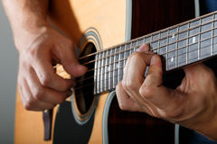 Acoustic guitar player performing song Royalty Free Stock Photography