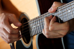 Acoustic guitar player performing song Stock Photography