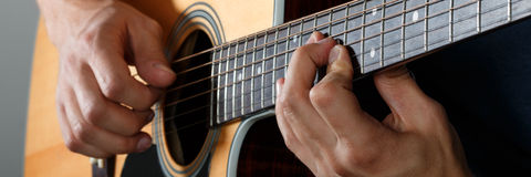 Acoustic guitar player performing song Stock Image