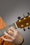 Acoustic guitar players left hand Royalty Free Stock Image