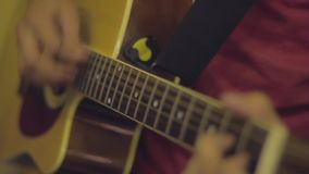 Acoustic guitar playing stock video footage